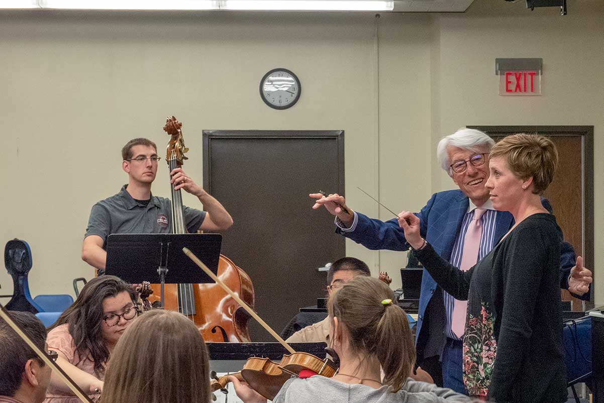Larry Livingston demonstrating how to conduct properly with a music educator.